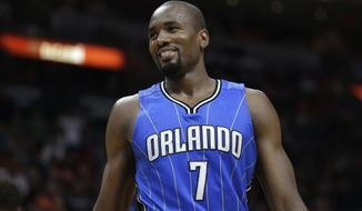Orlando Magic's Serge Ibaka (7) smiles after being called for a foul against Miami Heat's Goran Dragic (7) during the second half of an NBA basketball game, Monday, Feb. 13, 2017, in Miami. The Magic defeated the Heat 116-107. (AP Photo/Lynne Sladky)
