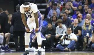 Sacramento Kings center DeMarcus Cousins pauses after being called for a technical foul during the first half of an NBA basketball game against the New Orleans Pelicans in Sacramento, Calif., Sunday, Feb. 12, 2017. (AP Photo/Steve Yeater)