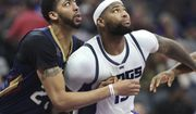 Sacramento Kings center DeMarcus Cousins (15) and New Orleans Pelicans center Anthony Davis (23) battle for position under the basket during the second half of an NBA basketball game in Sacramento, Calif., Sunday, Feb. 12, 2017. The Kings won 105-99. (AP Photo/Steve Yeater)