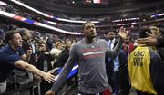 Washington Wizards guard Bradley Beal, center, greets fans after an NBA basketball game against the Oklahoma City Thunder, Monday, Feb. 13, 2017, in Washington. The Wizards won 120-98. (AP Photo/Nick Wass)