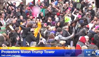 Hundreds of protesters showed up on Feb. 12, 2017, along the Chicago River to drop their pants while facing the Trump International Hotel & Tower. (ABC-7 Chicago screenshot)