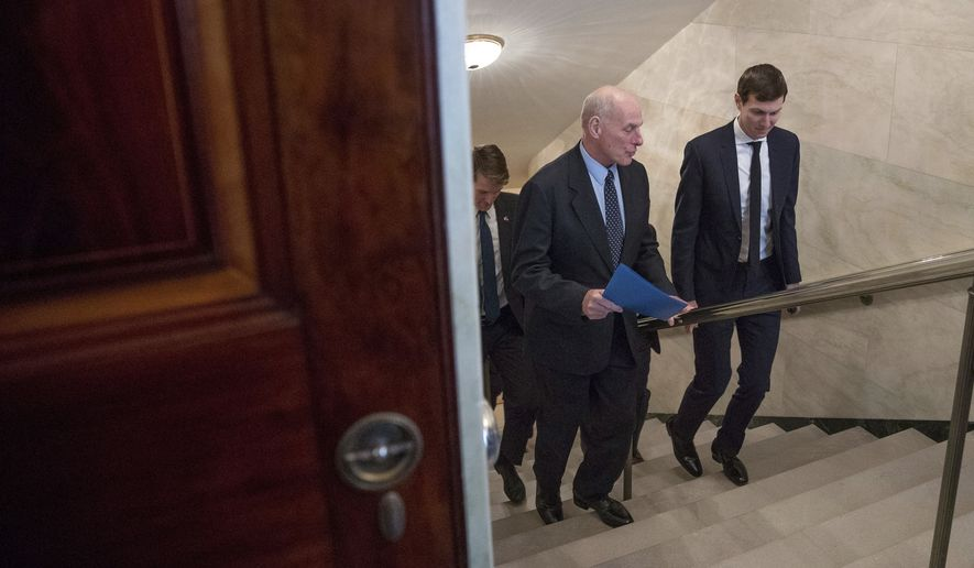 Homeland Security Secretary John Kelly, left, and President Donald Trump's White House Senior Adviser Jared Kushner walk to the main floor of the White House in Washington, Monday, Feb. 13, 2017, as President Donald Trump hosts Canadian Prime Minister Justin Trudeau. (AP Photo/Andrew Harnik)