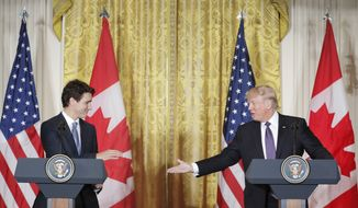 President Donald Trump extends his hand to Canadian Prime Minister Justin Trudeau during a joint news conference in the East Room of the White House in Washington, Monday, Feb. 13, 2017. (AP Photo/Pablo Martinez Monsivais)