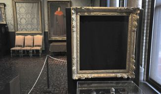 "FILE - In this March 11, 2010, file photo, empty frames from which thieves took ""Storm on the Sea of Galilee,"" left background, by Rembrandt and ""The Concert,"" right foreground, by Vermeer, remain on display at the Isabella Stewart Gardner Museum in Boston. The Mead Art Museum in Amherst, Mass., is offering visitors a unique glimpse of the 13 masterpieces stolen more than a quarter century ago from the Gardner Museum. The exhibit opening Tuesday, Feb. 14, 2017, shows the work of San Francisco-based artist Kota Ezawa. (AP Photo/Josh Reynolds, File)"