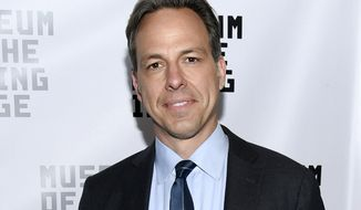 FILE - In this June 20, 2016 file photo, CNN news anchor Jake Tapper attends the Museum of the Moving Image's 2016 Industry Tribute in New York. Tapper is writing a debut novel scheduled to come out in the summer of 2018, Little, Brown and Company told The Associated Press on Monday, Feb. 13, 2017.  (Photo by Evan Agostini/Invision/AP, File)