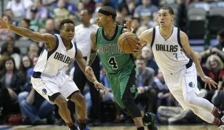 Boston Celtics guard Isaiah Thomas (4) dribbles against Dallas Mavericks defenders Yogi Ferrell (11) and Dwight Powell during the first half of an NBA basketball game in Dallas, Monday, Feb. 13, 2017. (AP Photo/LM Otero)