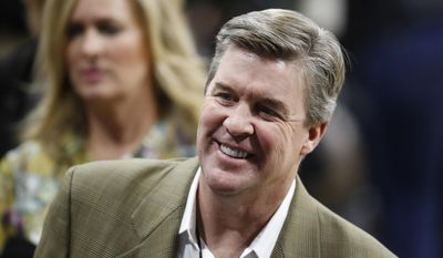 This Jan. 28, 2017 file photo shows Colorado head football coach Mike MacIntyre smiling as he makes his way through the crowd to watch Oregon play Colorado in an NCAA college basketball game in Boulder, Colo. MacIntyre's $16.25 million contract extension is being held up as the University of Colorado looks into his handling of domestic abuse allegations levied against a former assistant coach. (AP Photo/David Zalubowski)