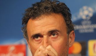 Barcelona's coach Luis Enrique pauses as he speaks during a press conference at the eve of the Champions League soccer match between Paris Saint Germain and Barcelona at the Parc des Princes stadium in Paris, Monday, Feb. 13, 2017. (AP Photo/Michel Euler)