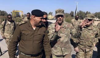 In this Wednesday, Feb. 8, 2017, file photo, U.S. Army Lt. Gen. Stephen Townsend talks with an Iraqi officer during a tour north of Baghdad, Iraq. (AP Photo/Ali Abdul Hassan, File)