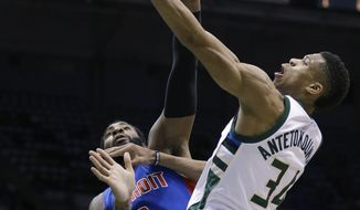 Milwaukee Bucks' Giannis Antetokounmpo (34) drives to the basket against the Detroit Pistons' Andre Drummond during the second half of an NBA basketball game Monday, Feb. 13, 2017, in Milwaukee. (AP Photo/Jeffrey Phelps)