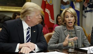 President Donald Trump listens as Secretary of Education Betsy DeVos speaks during a meeting with parents and teachers, Tuesday, Feb. 14, 2017, in the Roosevelt Room of the White House in Washington. (AP Photo/Evan Vucci) ** FILE **