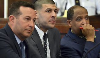 From left to right, lead defense attorney Jose Baez, Aaron Hernandez and attorney Ronald Sullivan listen to Judge Jeffrey Locke during motion hearings prior to Hernandez's double murder trial in Boston, Monday, Feb. 13, 2017. (Chris Christo/The Boston Herald via AP, Pool)