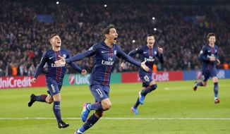 PSG's Angel Di Maria, second left, celebrates after scoring the first goal of the game during the Champion's League round of 16, first leg soccer match between Paris Saint Germain and Barcelona at the Parc des Princes stadium in Paris, Tuesday, Feb. 14, 2017. (AP Photo/Francois Mori)