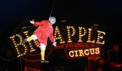 """FILE - This May 6, 2007 file photo shows Barry Lubin, as """" Grandma,"""" performing in the Big Apple Circus in Boston. Ringling Bros. and Barnum & Bailey Circus may be shuttering but Big Apple Circus has managed to cartwheel itself out of bankruptcy. A judge approved a deal, Tuesday, Feb. 14, 2017, that would save the circus by selling its tents, equipment and intellectual property to Big Top Works, an affiliate of the Florida-based investment firm Compass Partners LLC.  (AP Photo/Chitose Suzuki, File)"""