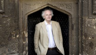 """In this Jan. 11, 2017 photo provide by Penguin Random House, author Philip Pullman poses for a photograph outside of Worcester College, in Oxford, England. The irrepressible young heroine of Pullman's fantasy saga """"His Dark Materials"""" returns in a new novel being published in Britain and the U.S. on Oct. 19, the first part of a trilogy called """"The Book of Dust."""" (Michael Leckie/Penguin Random House via AP)"""