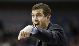 Boston Celtics head coach Brad Stevens yells from the sidelines during the first half of an NBA basketball game against the Dallas Mavericks in Dallas, Monday, Feb. 13, 2017. (AP Photo/LM Otero)