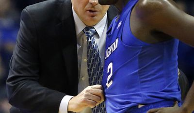 Creighton head coach Greg McDermott, left, talks with guard Khyri Thomas during the first half of an NCAA college basketball game against DePaul Saturday, Feb. 11, 2017, in Rosemont, Ill. (AP Photo/Nam Y. Huh)