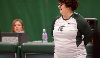 In this Feb. 19, 2016 photo, Michigan State University gymnastics head coach Kathie Klages reacts during the womens gymnastic's meet against Illinois at Jenison Field House in East Lansing, Mich. Klages says she's retiring immediately, Tuesday, Feb. 14, 2017, a day after the school announced her suspension. Klages has been coach for nearly 30 years. Her name has surfaced in lawsuits by female athletes who accuse a Michigan State sports doctor, Larry Nassar, of sexually abusing them during treatments. (Sundeep Dhanjal/The State News via AP)