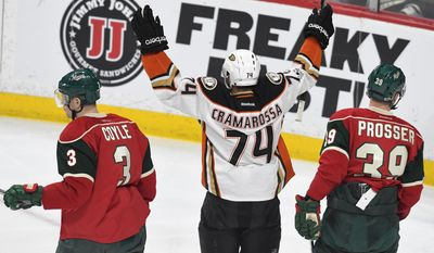 Anaheim Ducks' Joseph Cramarossa (74) celebrates his goal between Minnesota Wild's Charlie Coyle (3) and Nate Prosser, right in the first period of an NHL hockey game, Tuesday, Feb. 14, 2017, in St. Paul, Minn. (AP Photo/Tom Olmscheid)