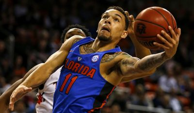 Florida guard Chris Chiozza (11) shoots against Florida during the first half of an NCAA college basketball game, Tuesday, Feb. 14, 2017, in Auburn, Ala. (AP Photo/Butch Dill)