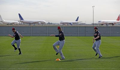 Cleveland Indians pitchers Bryan Shaw, left, Andrew Miller, center, and Cody Allen, right, warm up at the Indians baseball spring training facility Tuesday, Feb. 14, 2017, in Goodyear, Ariz. (AP Photo/Ross D. Franklin)