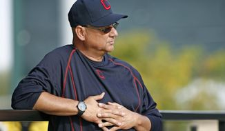 Cleveland Indians manager Terry Francona watches his players at the Indians baseball spring training facility Tuesday, Feb. 14, 2017, in Goodyear, Ariz. (AP Photo/Ross D. Franklin)