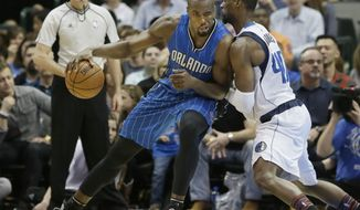 Orlando Magic forward Serge Ibaka (7) dribbles against Dallas Mavericks forward Harrison Barnes (40) during the second half of an NBA basketball in Dallas, Saturday, Feb. 11, 2017. (AP Photo/LM Otero)
