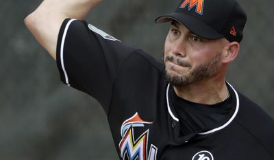 Miami Marlins relief pitcher Dustin McGowan throws during a spring training baseball workout Tuesday, Feb. 14, 2017, in Jupiter, Fla. (AP Photo/David J. Phillip)