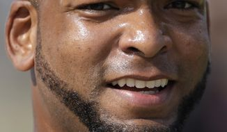 Miami Marlins relief pitcher Odrisamer Despaigne wears a beard during a spring training baseball workout Tuesday, Feb. 14, 2017, in Jupiter, Fla. Beards are back for the Marlins. The team has lifted its prohibition on facial hair after one season. The ban was adopted after Don Mattingly was hired as manager before the 2016 season. Speaking Tuesday before the first workout for pitchers and catchers, Mattingly said he reviewed the facial hair policy with owner Jeffrey Loria, and they decided to reverse it. (AP Photo/David J. Phillip)
