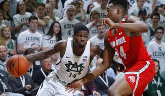 Michigan State's Eron Harris, left, drives against Ohio State's Andre Wesson during the first half of an NCAA college basketball game, Tuesday, Feb. 14, 2017, in East Lansing, Mich. (AP Photo/Al Goldis)