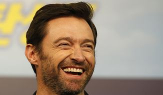 FILE - In this March 7, 2016, file photo, actor Hugh Jackman smiles during a press conference in Seoul, South Korea. Jackman posted a selfie on social media Feb. 13, 2017, showing off his bandaged nose following treatment for skin cancer. (AP Photo/Lee Jin-man, File)