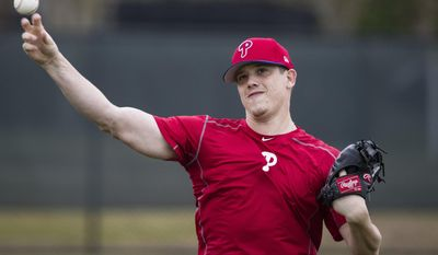 Philadelphia Phillies pitcher Jeremy Hellickson throws during a spring training baseball workout Monday, Feb. 13, 2017, in Clearwater, Fla. (AP Photo/Matt Rourke)