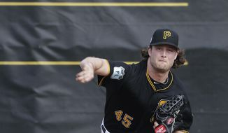 Pittsburgh Pirates pitcher Gerrit Cole throws during a workout at baseball spring training in Bradenton, Fla., Tuesday, Feb. 14, 2017. (AP Photo/David Goldman)