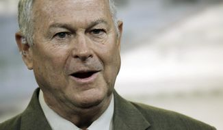 FILE - In this Nov. 13, 2013 file photo, Rep. Dana Rohrabacher, R-Calif., speaks during a news conference on Capitol Hill in Washington. Rohrabacher says a 71-year-old staffer was knocked unconscious Tuesday, Feb. 14, 2017, during an anti-Trump gathering at his Huntington Beach, Calif., office. A statement says district director Kathleen Staunton fell and hit her head Tuesday when a protester yanked open a door as she was leaving the office. But a member of the group Indivisible 48 says it didn't happen that way. (AP Photo/Lauren Victoria Burke, File)