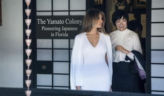 First Lady Melania Trump and Akie Abe, wife of Japanese Prime Minister Shinzo Abe take a tour on Yamato Island at the Morikami Museum and Japanese Gardens in Delray Beach, Fla., on Saturday, Feb. 11, 2017.   (Michael Ares/Palm Beach Post via AP)