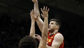 Maryland center Michal Cekovsky, right, shoots over Northwestern center Barret Benson during the first half of an NCAA college basketball game Wednesday, Feb. 15, 2017, in Evanston, Ill. (AP Photo/Nam Y. Huh)