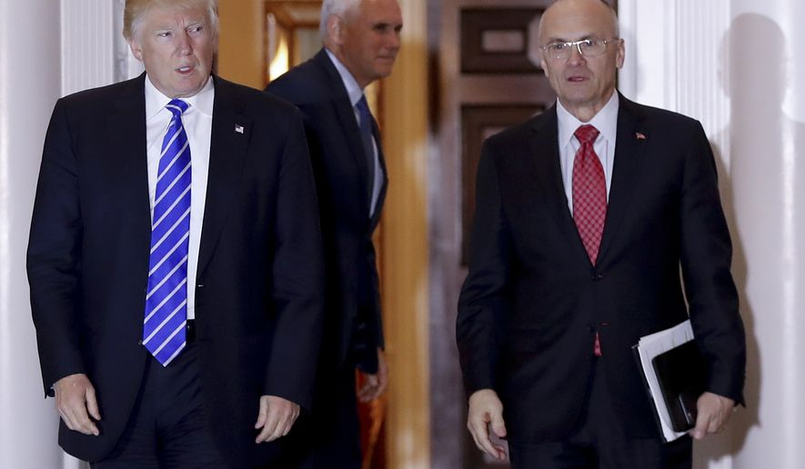 Then-President-elect Donald Trump walks Labor Secretary-designate Andy Puzder from Trump National Golf Club Bedminster clubhouse in Bedminster, N.J., in this Nov. 19, 2016, file photo. (AP Photo/Carolyn Kaster, File)