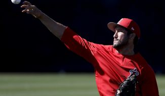 Los Angeles Angels relief pitcher Huston Street throws during spring baseball practice in Tempe, Ariz., Wednesday, Feb. 15, 2017. (AP Photo/Chris Carlson)
