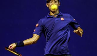 Japan's Kei Nishikori eyes the ball during an ATP Argentina Open tennis match against Diego Schwartzman of Argentina, in Buenos Aires, Argentina, Wednesday, Feb. 15, 2017. (AP Photo/Agustin Marcarian)