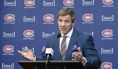 Montreal Canadiens general manager Marc Bergevin pauses as he comments on the team's coaching change during an NHL news conference, Wednesday, Feb. 15, 2017, in Brossard, Quebec. In the midst of losing their grip on first place, the Montreal Canadiens abruptly fired coach Michel Therrien on Tuesday and hired Claude Julien in hopes of getting their season back on track. *Paul Chiasson/The Canadian Press via AP)