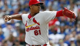 FILE - In this Sept. 24, 2016, file photo, St. Louis Cardinals starter Alex Reyes throws against the Chicago Cubs during the first inning of a baseball game in Chicago. Reyes needs season-ending Tommy John surgery on his right arm. General manager John Mozeliak confirmed the diagnosis after an MRI. Reyes didn't throw his scheduled bullpen session Tuesday, Feb. 14. 2017,  because of a sore elbow. (AP Photo/Nam Y. Huh, File)