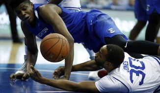 Creighton center Justin Patton, left, and Seton Hall guard Madison Jones struggle for a loose ball during the first half of an NCAA college basketball game, Wednesday, Feb. 15, 2017, in Newark, N.J. (AP Photo/Julio Cortez)