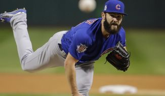 FILE - In this Oct. 26, 2016, file photo, Chicago Cubs starting pitcher Jake Arrieta throws during the first inning of Game 2 of the Major League Baseball World Series against the Cleveland Indians, in Cleveland. Arrieta is hopeful of receiving a contract extension with the Cubs before he becomes eligible for free agency after the 2017 season, yet he also realizes this could be his final year with the club if talks don't materialize. (AP Photo/Gene J. Puskar, File)