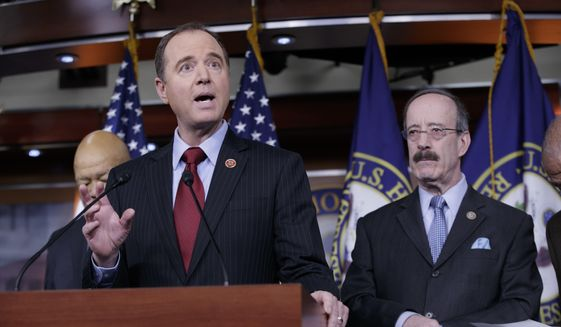 Rep. Adam Schiff, D-Calif., ranking member of the House Permanent Select Committee on Intelligence, left, and Rep. Eliot Engel, D-N.Y., ranking member of the House Foreign Affairs Committee, join other Democrats to say they want an investigation into President Donald Trump's relationship with Russia, including when Trump learned that his national security adviser, Michael Flynn, had discussed U.S. sanctions with a Russian diplomat, during a news conference on Capitol Hill in Washington, Tuesday, Feb. 14, 2017. (AP Photo/J. Scott Applewhite)