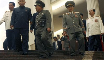 """FILE - In this July 27, 2013 file photo, North Korean leader Kim Jong Un, second left, tours the newly-opened Fatherland Liberation War Museum, with his uncle Jang Song Thaek, right, Yang Hyong Sop, second right, vice president of the Presidium of North Korea's parliament, and Vice Marshal Choe Ryong Hae, left, as part of celebrations for the 60th anniversary of the Korean War armistice in Pyongyang, North Korea. Since taking power in late 2011, Kim Jong Un has executed or purged a slew of high-level government officials in what the South Korean government has described as a """"reign of terror."""" The most spectacular was the 2013 execution by anti-aircraft fire of his uncle, Jang, once considered the country's second-most-powerful man, for what the North alleged was treason.(AP Photo/Wong Maye-E, File)"""