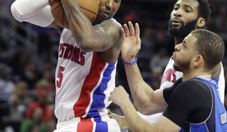 Detroit Pistons guard Kentavious Caldwell-Pope (5) grabs a rebound next to Dallas Mavericks guard Seth Curry during the first half of an NBA basketball game, Wednesday, Feb. 15, 2017, in Auburn Hills, Mich. (AP Photo/Carlos Osorio)