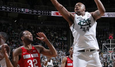 Michigan State's Nick Ward, right, pulls down a rebound against Ohio State's Trevor Thompson (32) during the first half of an NCAA college basketball game, Tuesday, Feb. 14, 2017, in East Lansing, Mich. (AP Photo/Al Goldis)