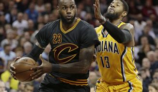 Cleveland Cavaliers' LeBron James (23) drives against Indiana Pacers' Paul George (13) in the first half of an NBA basketball game, Wednesday, Feb. 15, 2017, in Cleveland. (AP Photo/Tony Dejak)