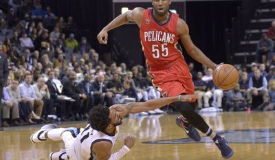 New Orleans Pelicans guard E'Twaun Moore (55) drives past Memphis Grizzlies guard Mike Conley (11) as he falls to the court in the first half of an NBA basketball game Wednesday, Feb. 15, 2017, in Memphis, Tenn. (AP Photo/Brandon Dill)