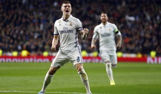 Real Madrid's Toni Kroos celebrates after scoring his side's second goal during the Champions League round of 16, first leg, soccer match between Real Madrid and Napoli at the Santiago Bernabeu stadium in Madrid, Wednesday Feb. 15, 2017. (AP Photo/Francisco Seco)